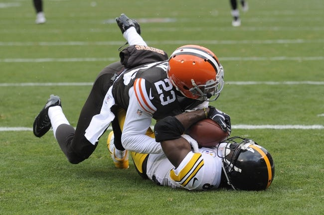 Nov 24, 2013; Cleveland, OH, USA; Pittsburgh Steelers wide receiver Antonio Brown (84) catches a touchdown under the coverage of Cleveland Browns cornerback Joe Haden (23) during the second quarter at FirstEnergy Stadium. The Steelers beat the Browns 27-11. Mandatory Credit: Ken Blaze-USA TODAY Sports