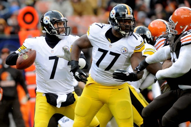 Nov 24, 2013; Cleveland, OH, USA; Pittsburgh Steelers quarterback Ben Roethlisberger (7) passes behind the blocking of tackle Marcus Gilbert (77) against the Cleveland Browns at FirstEnergy Stadium. Mandatory Credit: Ken Blaze-USA TODAY Sports