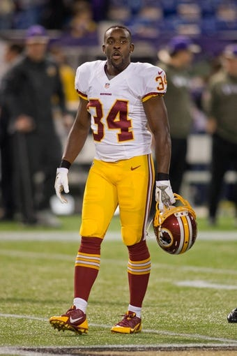 Nov 7, 2013; Minneapolis, MN, USA; Washington Redskins safety Trenton Robinson (34) rests in drills before the game against the Minnesota Vikings at Mall of America Field at H.H.H. Metrodome. The Vikings win 34-27. Mandatory Credit: Bruce Kluckhohn-USA TODAY Sports