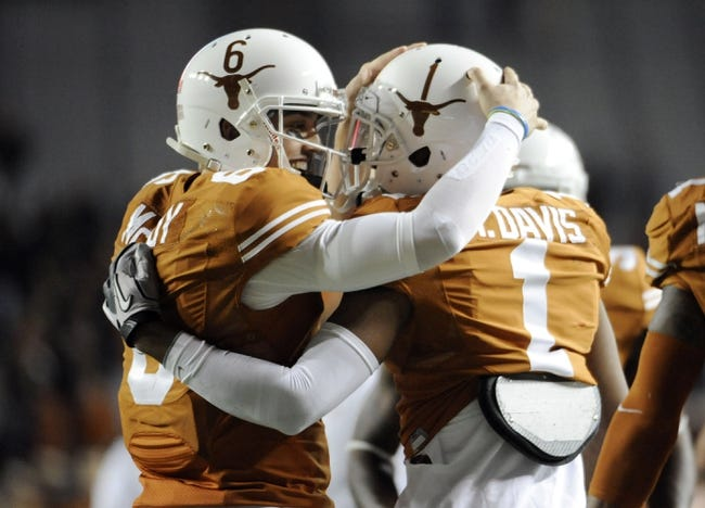 Nov 28, 2013; Austin, TX, USA; Texas Longhorns quarterback Case McCoy (6) and wide receiver Mike Davis (1) react after a touchdown against the Texas Tech Red Raiders during the second half at Darrell K Royal-Texas Memorial Stadium. Texas beat Texas Tech 41-16. Mandatory Credit: Brendan Maloney-USA TODAY Sports