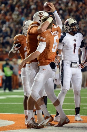 Nov 28, 2013; Austin, TX, USA; Texas Longhorns quarterback Case McCoy (6) and tight end Geoff Swain (82) react after a touchdown against the Texas Tech Red Raiders during the second half at Darrell K Royal-Texas Memorial Stadium. Texas beat Texas Tech 41-16. Mandatory Credit: Brendan Maloney-USA TODAY Sports
