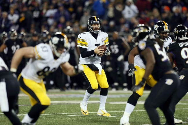 Nov 28, 2013; Baltimore, MD, USA; Pittsburgh Steelers quarterback Ben Roethlisberger (7) drops back to pass against the Baltimore Ravens during a NFL football game on Thanksgiving at M&T Bank Stadium. Mandatory Credit: Mitch Stringer-USA TODAY Sports