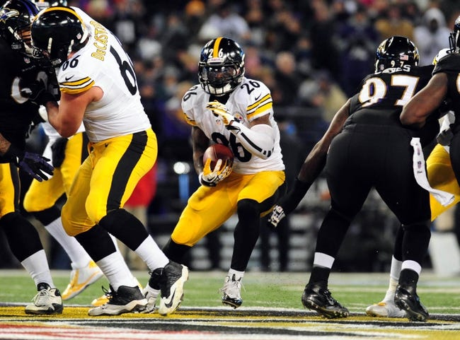Nov 28, 2013; Baltimore, MD, USA; Pittsburgh Steelers running back Le'Veon Bell (26) runs with the ball against the Baltimore Ravens during a NFL football game on Thanksgiving at M&T Bank Stadium. Mandatory Credit: Evan Habeeb-USA TODAY Sports