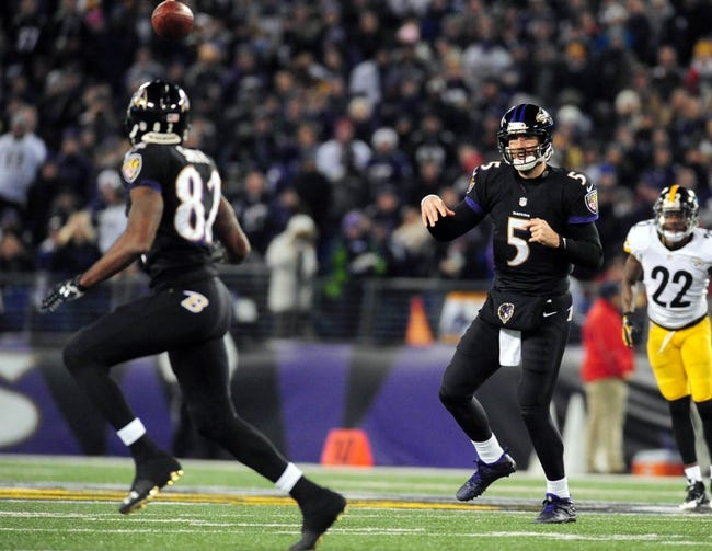 Nov 28, 2013; Baltimore, MD, USA; Baltimore Ravens quarterback Joe Flacco (5) throws the ball to wide receiver Torrey Smith (82) against the Pittsburgh Steelers during a NFL football game on Thanksgiving at M&T Bank Stadium. Mandatory Credit: Evan Habeeb-USA TODAY Sports