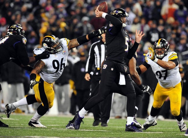 Nov 28, 2013; Baltimore, MD, USA; Pittsburgh Steelers defensive end Ziggy Hood (96) reaches for Baltimore Ravens quarterback Joe Flacco (5) during a NFL football game on Thanksgiving at M&T Bank Stadium. Mandatory Credit: Evan Habeeb-USA TODAY Sports