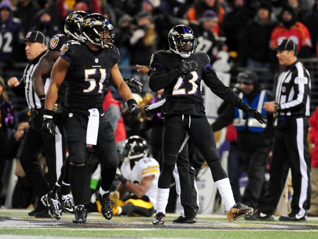 Nov 28, 2013; Baltimore, MD, USA; Baltimore Ravens cornerback Chykie Brown (23) celebrates after breaking up a two point conversion against the Pittsburgh Steelers during a NFL football game on Thanksgiving at M&T Bank Stadium. Mandatory Credit: Evan Habeeb-USA TODAY Sports