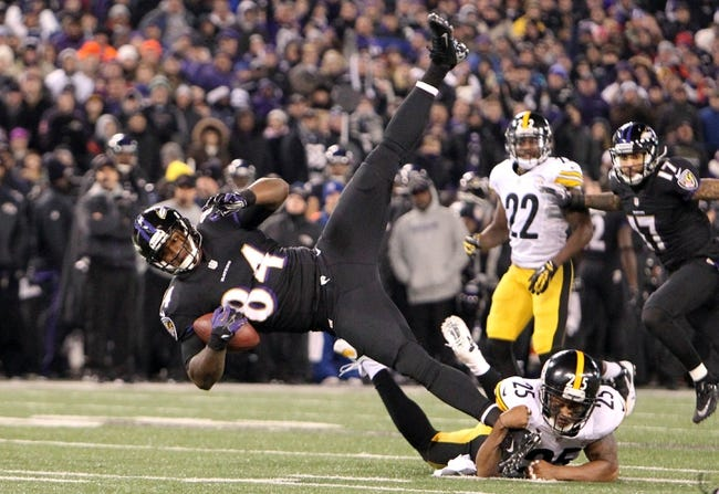 Nov 28, 2013; Baltimore, MD, USA; Baltimore Ravens tight end Ed Dickson (84) is tackled by Pittsburgh Steelers safety Ryan Clark (25) during the NFL football game on Thanksgiving at M&T Bank Stadium. Mandatory Credit: Mitch Stringer-USA TODAY Sports