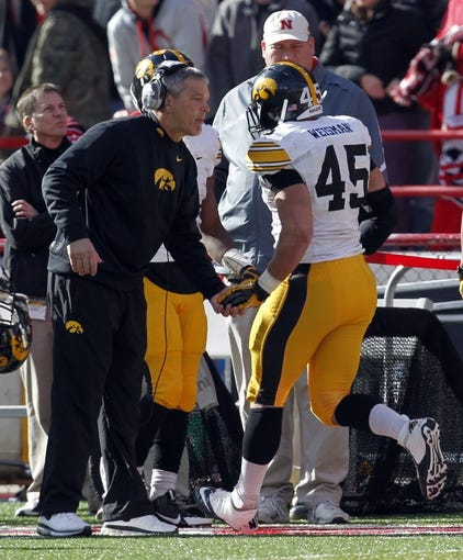 Nov 29, 2013; Lincoln, NE, USA; Iowa Hawkeyes head coach Kirk Ferentz congratulates running back Mark Weisman (45) after he scored a touchdown against Nebraska Cornhuskers in the second quarter at Memorial Stadium. Mandatory Credit: Bruce Thorson-USA TODAY Sports