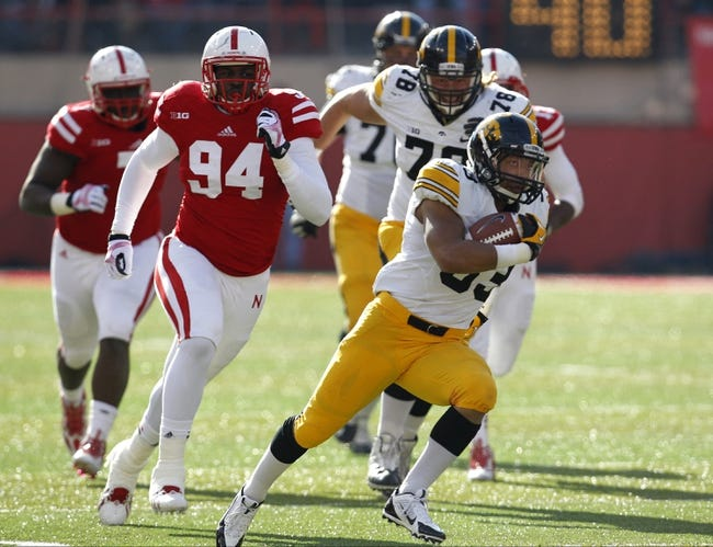 Nov 29, 2013; Lincoln, NE, USA; Iowa Hawkeyes running back Jordan Canzeri (33) runs against Nebraska Cornhuskers in the second quarter at Memorial Stadium. Mandatory Credit: Bruce Thorson-USA TODAY Sports