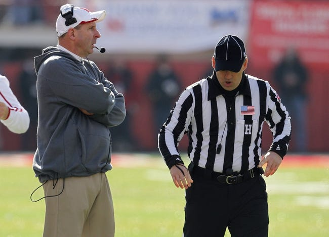 Nov 29, 2013; Lincoln, NE, USA; Nebraska Cornhuskers head coach Bo Pelini talks to an official during the game against the Iowa Hawkeyes in the second quarter at Memorial Stadium. Mandatory Credit: Bruce Thorson-USA TODAY Sports