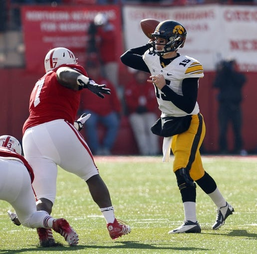Nov 29, 2013; Lincoln, NE, USA; Iowa Hawkeyes quarterback Jake Rudock (15) throws against Nebraska Cornhuskers defender Maliek Collins (7) in the second quarter at Memorial Stadium. Mandatory Credit: Bruce Thorson-USA TODAY Sports