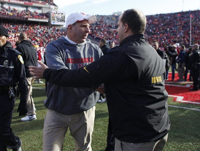 Nov 29, 2013; Lincoln, NE, USA; Nebraska Cornhuskers head coach Bo Pelini and Iowa Hawkeyes defensive coordinator Phil Parker greet each other after the game at Memorial Stadium. Iowa won 38-17. Mandatory Credit: Bruce Thorson-USA TODAY Sports