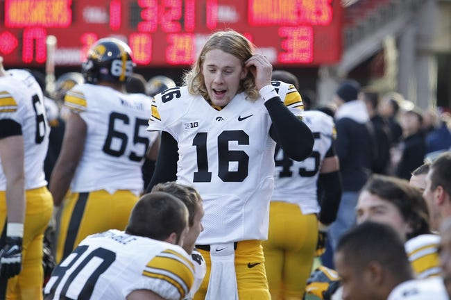 Nov 29, 2013; Lincoln, NE, USA; Iowa Hawkeyes quarterback C.J. Beathard (16) laughs with teammates in the final moments during the game against the Nebraska Cornhuskers in the fourth quarter at Memorial Stadium. Iowa won 38-17. Mandatory Credit: Bruce Thorson-USA TODAY Sports
