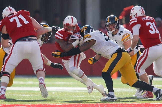 Nov 29, 2013; Lincoln, NE, USA; Nebraska Cornhuskers running back Ameer Abdullah (8) is tackled by Iowa Hawkeyes defender Anthony Hitchens (31) forcing a fumble in the fourth quarter at Memorial Stadium. Iowa won 38-17. Mandatory Credit: Bruce Thorson-USA TODAY Sports