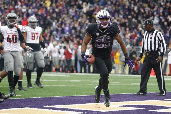 Nov 29, 2013; Seattle, WA, USA; Washington Huskies running back Bishop Sankey (25) rushes for a touchdown against the Washington State Cougars during the second half at Husky Stadium. Mandatory Credit: Joe Nicholson-USA TODAY Sports