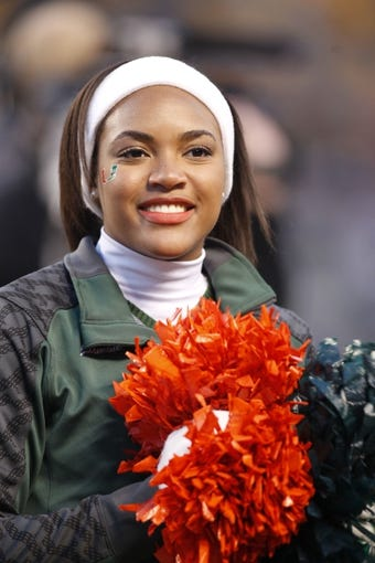 Nov 29, 2013; Pittsburgh, PA, USA; Miami Hurricanes cheerleader cheers on the team against the Pittsburgh Panthers during the second quarter at Heinz Field. Miami won 41-31. Mandatory Credit: Charles LeClaire-USA TODAY Sports