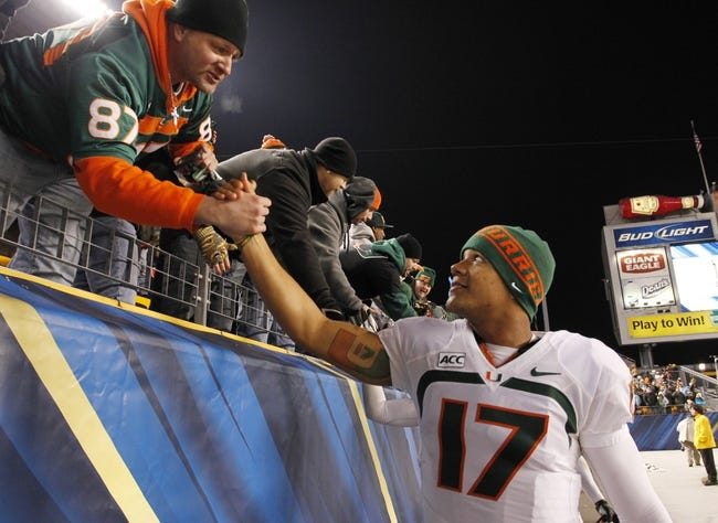 Nov 29, 2013; Pittsburgh, PA, USA; Miami Hurricanes quarterback Stephen Morris (17) celebrates with the fans after defeating the Pittsburgh Panthers at Heinz Field. Miami won 41-31. Mandatory Credit: Charles LeClaire-USA TODAY Sports