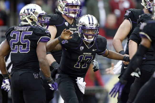 Nov 29, 2013; Seattle, WA, USA; Washington Huskies quarterback Keith Price (17) celebrates after rushing for a touchdown against the Washington State Cougars late during the fourth quarter at Husky Stadium. Mandatory Credit: Joe Nicholson-USA TODAY Sports
