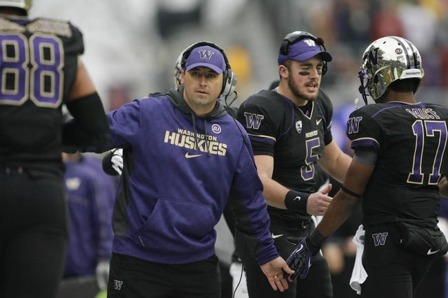 Nov 29, 2013; Seattle, WA, USA; Washington Huskies head coach Steve Sarkisian greets his offensive unit following a touchdown against the Washington State Cougars during the third quarter at Husky Stadium. Mandatory Credit: Joe Nicholson-USA TODAY Sports