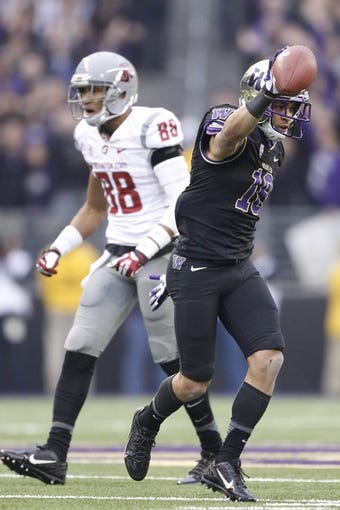 Nov 29, 2013; Seattle, WA, USA; Washington Huskies defensive back Gregory Ducre (18) stands up after intercepting a pass intended for Washington State Cougars wide receiver Isiah Myers (88) during the fourth quarter at Husky Stadium. Mandatory Credit: Joe Nicholson-USA TODAY Sports