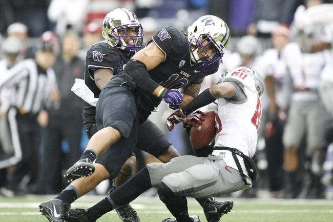 Nov 29, 2013; Seattle, WA, USA; Washington Huskies linebacker John Timu (10) hits Washington State Cougars wide receiver Dom Williams (80) after Williams caught a pass during the fourth quarter at Husky Stadium. Mandatory Credit: Joe Nicholson-USA TODAY Sports