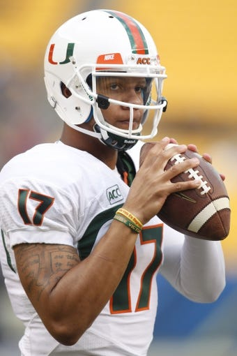 Nov 29, 2013; Pittsburgh, PA, USA; Miami Hurricanes quarterback Stephen Morris (17) warms up before playing the Pittsburgh Panthers at Heinz Field. Miami won 41-31. Mandatory Credit: Charles LeClaire-USA TODAY Sports