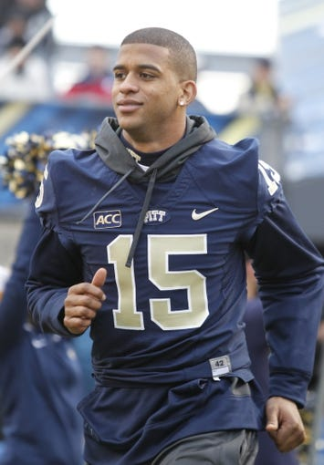 Nov 29, 2013; Pittsburgh, PA, USA; Pittsburgh Panthers wide receiver Devin Street (15) takes the field on senior day against the Miami Hurricanes during the first quarter at Heinz Field. Miami won 41-31. Mandatory Credit: Charles LeClaire-USA TODAY Sports