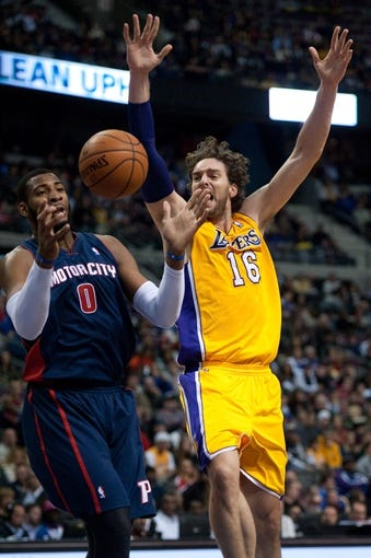 Nov 29, 2013; Auburn Hills, MI, USA; Detroit Pistons center Andre Drummond (0) fouls Los Angeles Lakers center Pau Gasol (16) during the second quarter at The Palace of Auburn Hills. Mandatory Credit: Tim Fuller-USA TODAY Sports