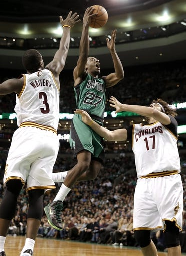 Nov 29, 2013; Boston, MA, USA; Boston Celtics shooting guard Jordan Crawford (27) drives between Cleveland Cavaliers shooting guard Dion Waiters (3) and center Anderson Varejao (17) during the second quarter at TD Garden. Mandatory Credit: Winslow Townson-USA TODAY Sports