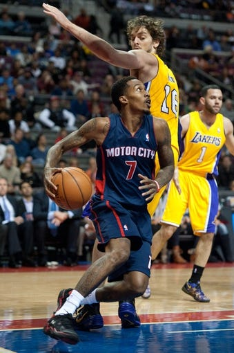 Nov 29, 2013; Auburn Hills, MI, USA; Detroit Pistons point guard Brandon Jennings (7) drives past Los Angeles Lakers center Pau Gasol (16) during the fourth quarter at The Palace of Auburn Hills. Lakers won 106-102. Mandatory Credit: Tim Fuller-USA TODAY Sports