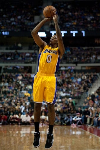Nov 29, 2013; Auburn Hills, MI, USA; Los Angeles Lakers small forward Nick Young (0) during the first quarter against the Detroit Pistons at The Palace of Auburn Hills. Mandatory Credit: Tim Fuller-USA TODAY Sports