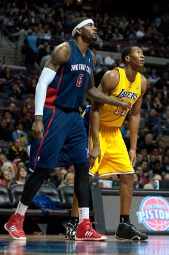 Nov 29, 2013; Auburn Hills, MI, USA; Detroit Pistons small forward Josh Smith (6) and Los Angeles Lakers shooting guard Wesley Johnson (11) during the second quarter at The Palace of Auburn Hills. Mandatory Credit: Tim Fuller-USA TODAY Sports