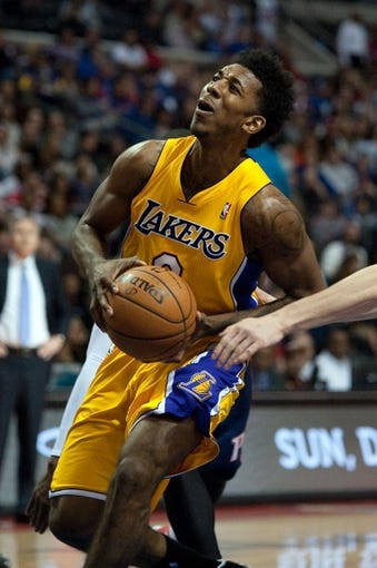 Nov 29, 2013; Auburn Hills, MI, USA; Los Angeles Lakers small forward Nick Young (0) drives to the basket during the second quarter against the Detroit Pistons at The Palace of Auburn Hills. Mandatory Credit: Tim Fuller-USA TODAY Sports