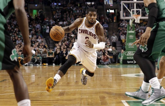 Nov 29, 2013; Boston, MA, USA; Cleveland Cavaliers point guard Kyrie Irving (2) drives between two Boston Celtics during the second half of Boston's 103-86 win at TD Garden. Mandatory Credit: Winslow Townson-USA TODAY Sports