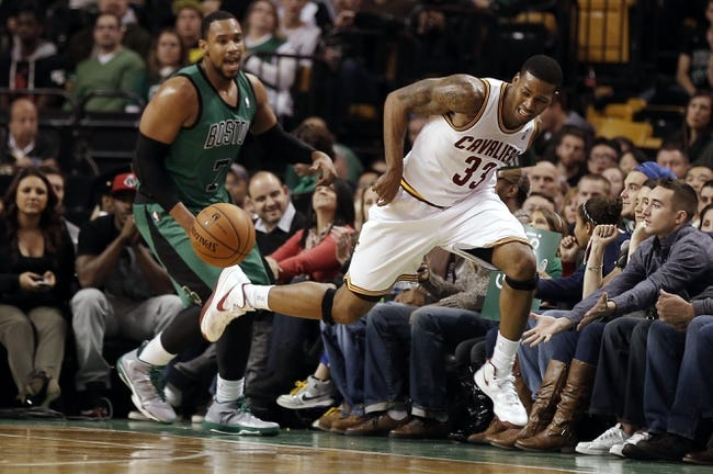 Nov 29, 2013; Boston, MA, USA; Cleveland Cavaliers small forward Alonzo Gee (33) tries to keep the ball inbounds as Boston Celtics power forward Jared Sullinger (7) looks on during the second half of Boston's 103-86 win at TD Garden. Mandatory Credit: Winslow Townson-USA TODAY Sports