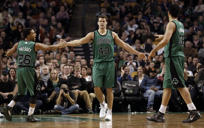 Nov 29, 2013; Boston, MA, USA; Boston Celtics power forward Kris Humphries (43) is congratulated after a basket by teammates point guard Phil Pressey (26) and center Vitor Faverani (38) during the second half of Boston's 103-86 win over the Cleveland Cavaliers at TD Garden. Mandatory Credit: Winslow Townson-USA TODAY Sports
