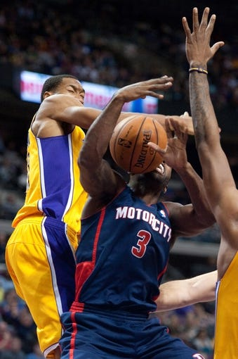 Nov 29, 2013; Auburn Hills, MI, USA; Detroit Pistons shooting guard Rodney Stuckey (3) goes to the basket against Los Angeles Lakers shooting guard Wesley Johnson (11) during the third quarter at The Palace of Auburn Hills. Lakers won 106-102. Mandatory Credit: Tim Fuller-USA TODAY Sports