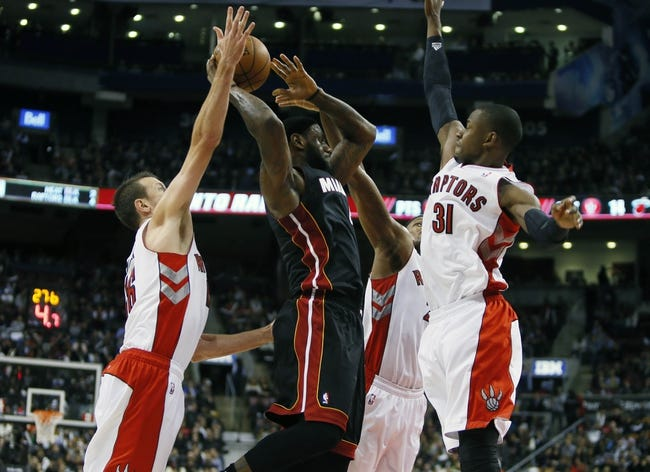 Nov 29, 2013; Toronto, Ontario, CAN; Miami Heat forward LeBron James (6) tries to shoot as Toronto Raptors guard Terrence Ross (31) and forward Steve Novak (16) defend at the Air Canada Centre. Miami defeated Toronto 90-83. Mandatory Credit: John E. Sokolowski-USA TODAY Sports