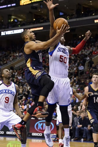 Nov 29, 2013; Philadelphia, PA, USA; New Orleans Pelicans guard Eric Gordon (10)  shoots under pressure from Philadelphia 76ers center Lavoy Allen (50) at the Wells Fargo Center. The Pelicans defeated the Sixers 121-105. Mandatory Credit: Howard Smith-USA TODAY Sports