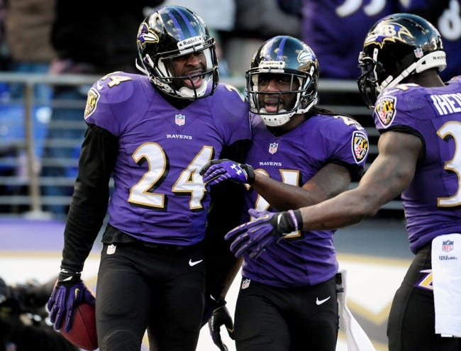 Nov 24, 2013; Baltimore, MD, USA; Baltimore Ravens cornerback Corey Graham (24) is congratulated by cornerback Lardarius Webb (21) after intercepting a pass at M&T Bank Stadium. Mandatory Credit: Evan Habeeb-USA TODAY Sports