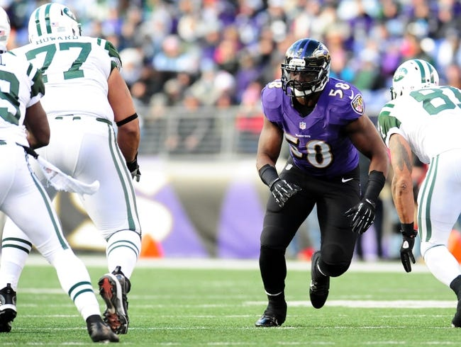 Nov 24, 2013; Baltimore, MD, USA; Baltimore Ravens linebacker Elvis Dumervil (58) rushes the passer during the game against the New York Jets at M&T Bank Stadium. Mandatory Credit: Evan Habeeb-USA TODAY Sports