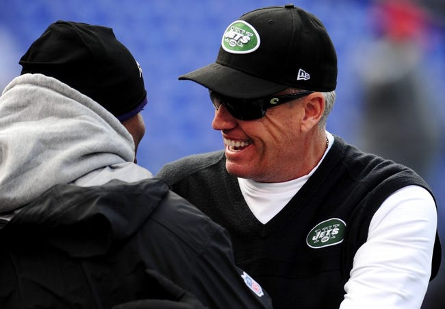 Nov 24, 2013; Baltimore, MD, USA; New York Jets head coach Rex Ryan (right) talks to coaches prior to the game against the Baltimore Ravens at M&T Bank Stadium. Mandatory Credit: Evan Habeeb-USA TODAY Sports