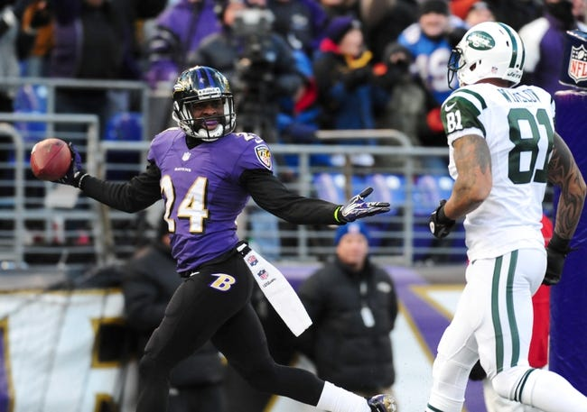 Nov 24, 2013; Baltimore, MD, USA; Baltimore Ravens cornerback Corey Graham (24) gestures at New York Jets tight end Kellen Winslow (81) after intercepting a pass at M&T Bank Stadium. Mandatory Credit: Evan Habeeb-USA TODAY Sports