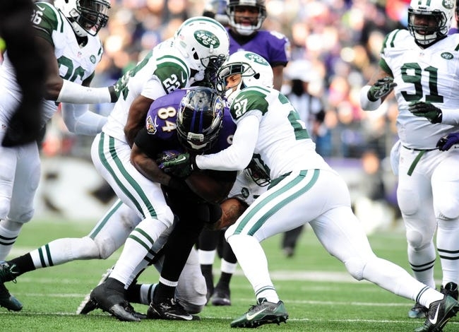 Nov 24, 2013; Baltimore, MD, USA; Baltimore Ravens tight end Ed Dickson (84) is tackled by New York Jets safety Ed Reed (22) and cornerback Dee Milliner (27) at M&T Bank Stadium. Mandatory Credit: Evan Habeeb-USA TODAY Sports