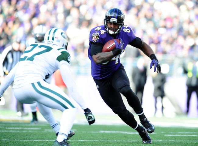 Nov 24, 2013; Baltimore, MD, USA; Baltimore Ravens tight end Ed Dickson (84) runs with the ball in front of New York Jets cornerback Dee Milliner (27) at M&T Bank Stadium. Mandatory Credit: Evan Habeeb-USA TODAY Sports