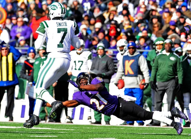 Nov 24, 2013; Baltimore, MD, USA; New York Jets quarterback Geno Smith (7) is tackled by Baltimore Ravens cornerback Lardarius Webb (21) at M&T Bank Stadium. Mandatory Credit: Evan Habeeb-USA TODAY Sports