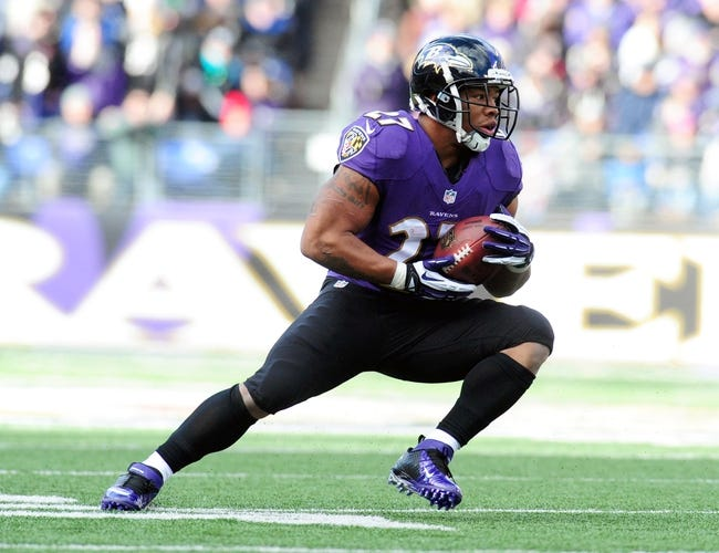 Nov 24, 2013; Baltimore, MD, USA; Baltimore Ravens running back Ray Rice (27) runs with the ball during the game against the New York Jets at M&T Bank Stadium. Mandatory Credit: Evan Habeeb-USA TODAY Sports