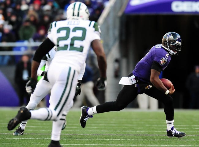 Nov 24, 2013; Baltimore, MD, USA; Baltimore Ravens quarterback Tyrod Taylor (2) runs with the ball during the game against the New York Jets at M&T Bank Stadium. Mandatory Credit: Evan Habeeb-USA TODAY Sports