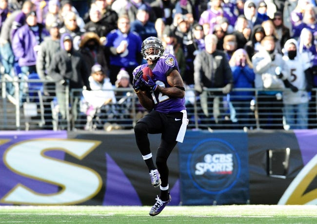 Nov 24, 2013; Baltimore, MD, USA; Baltimore Ravens wide receiver Jacoby Jones (12) catches a punt during the game against the New York Jets at M&T Bank Stadium. Mandatory Credit: Evan Habeeb-USA TODAY Sports