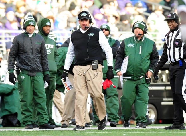 Nov 24, 2013; Baltimore, MD, USA; New York Jets head coach Rex Ryan (center) holds the challenge flag during the game against the Baltimore Ravens at M&T Bank Stadium. Mandatory Credit: Evan Habeeb-USA TODAY Sports